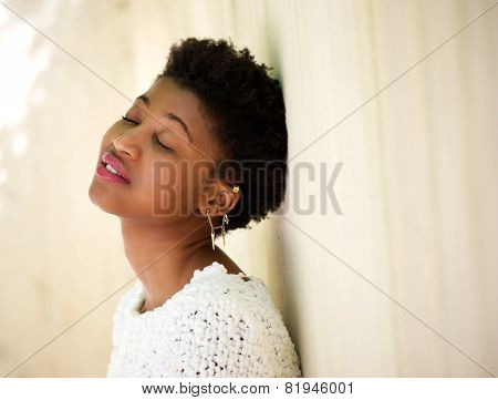 Young Black Woman Resting With Eyes Closed
