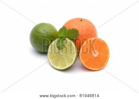 Limes And Tangerines On White Background