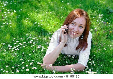 The Girl With The Phone On The Grass