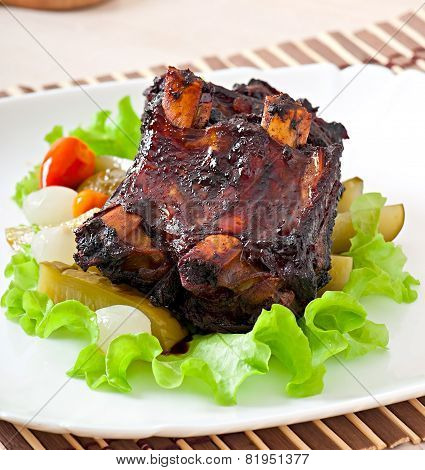 Baked beef ribs in honey soy marinade with pickled vegetables