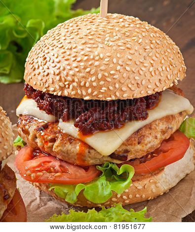 American burger with chicken and bacon, homemade barbecue sauce