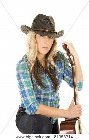 Cowgirl With Guitar In Blue Black Hat Looking