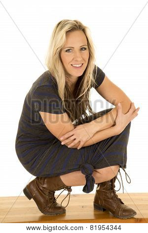 Woman Dark Dress Sit Boots And Smile