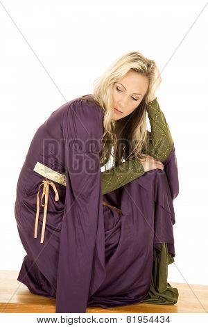 Woman In A Purple Dress Kneel Look Down
