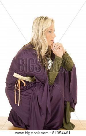 Woman In A Purple Dress Look To Side