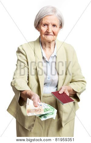 Senior woman giving money and holding passport
