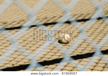 Baseball throught fence