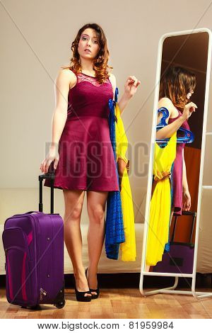 Girl With Clothes And Suitcase At Home, Travel