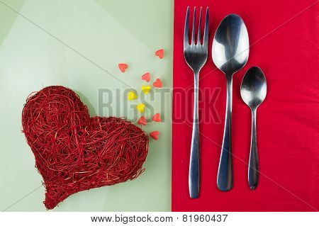 Valentines day table setting with plate red ribbon and hearts