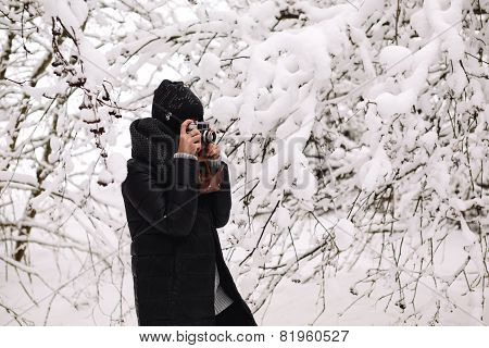 Girl photographed in the winter forest