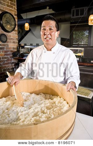 Japanese Chef Preparing Rice For Sushi