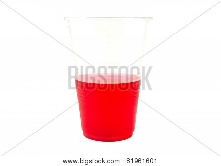 Red gelatin in a plastic cup isolated on white background.