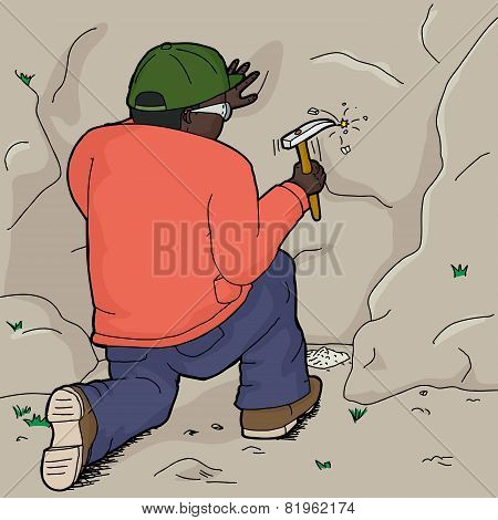 African Geologist Working On Rock