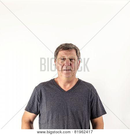 Astonished  Senior Man Looking At Camera