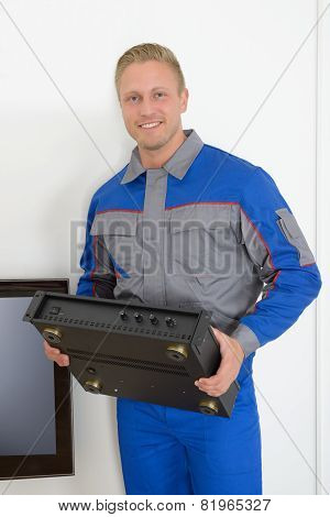 Technician Holding Amplifier