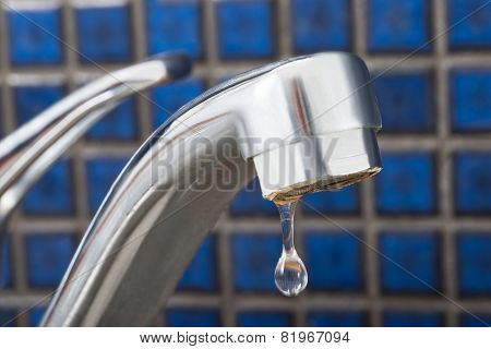 Water Drop Dripping From Tap