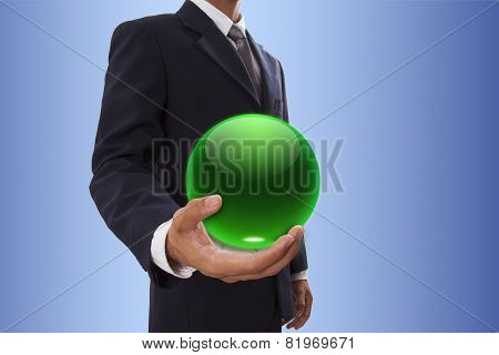 Businessman hand holding crystal ball.