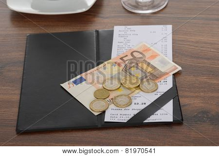 Bill With Euro Note On Table