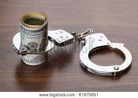 Dollar Bills With Handcuffs
