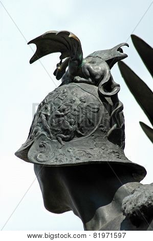 Small Dragon On A Helmet. Detail On A Public Statue In Arad, Romania