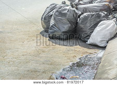 Image Of Black Garbage Bag On The Roadside.