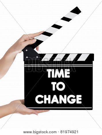 Hands Holding A Clapper Board With Time To Change Text