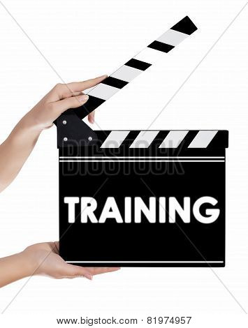 Hands Holding A Clapper Board With Training Text