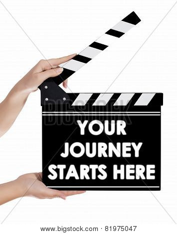 Hands Holding A Clapper Board With Your Journey Starts Here Text
