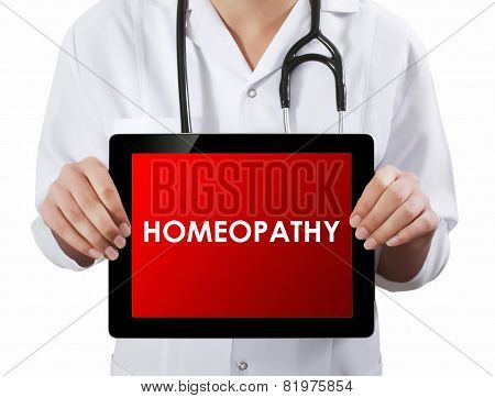 Doctor Showing Tablet With Homeopathy Text.