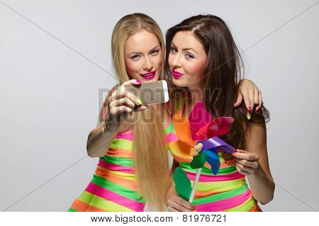Girls taking selfie with smartphone