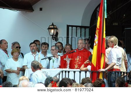 Spanish Priest giving surmon.
