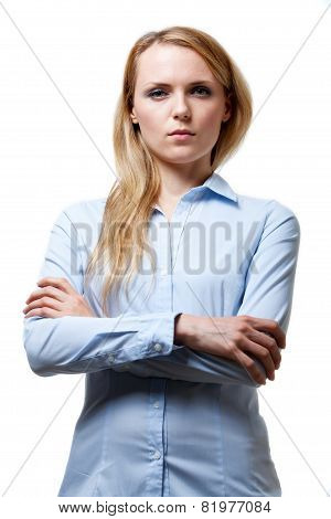 Young blond serious woman with folded arms