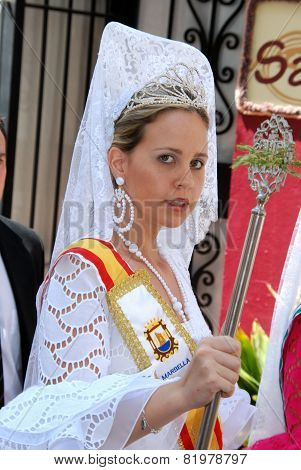 Spanish girl in traditional dress.