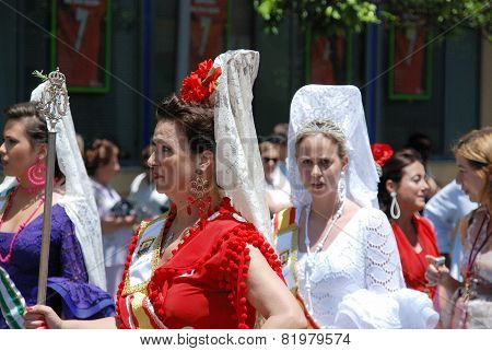 Spanish women in traditional dress.