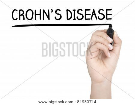 Hand With Pen Writing Crohns Disease On Whiteboard