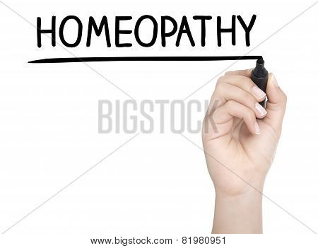 Hand With Pen Writing Homeopathy On Whiteboard