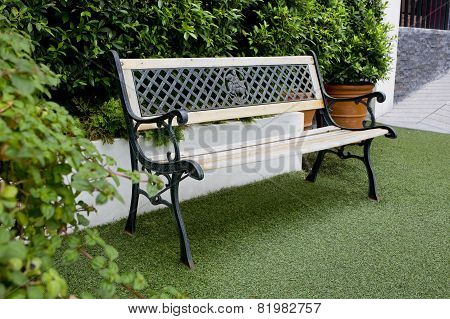 White Classic Bench In The Garden
