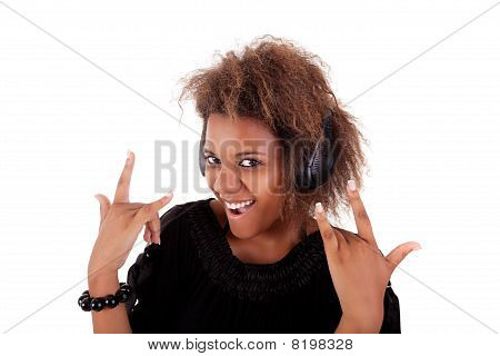 Beautiful Black Woman Listening Music In Headphones, Isolated On White Background, Studio Shot