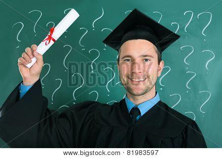 Graduate Man Holding Diploma Certificate