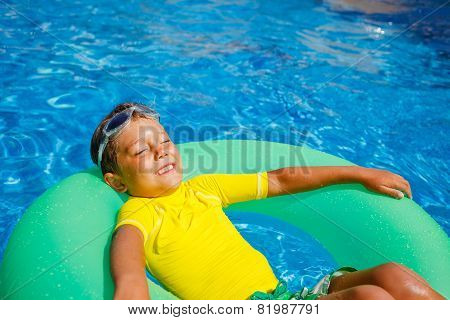 Boy swims in a pool