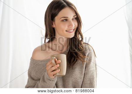 Closeup of girl with cup enjoying new day