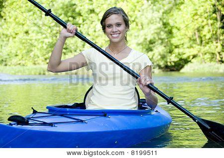 Active Female In Kayak