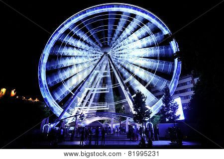 Ferris Wheel At Amusement Park At Night