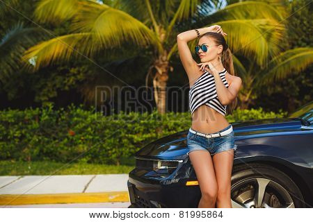 Young woman traveling by car the cities of America.