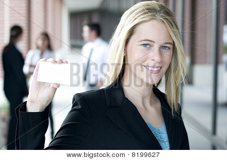 Attractive Businesswoman Holding A Card