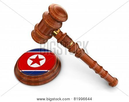 Wooden Mallet and North Korean flag (clipping path included)