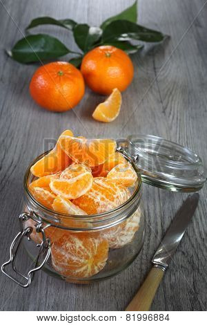 Ripe Mandarins In A Glass Jar