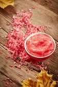 pic of scrubs  - Pink sea salt and scrub for body on wooden background - JPG