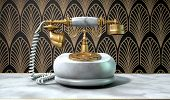 pic of embellish  - A vintage marble and brass telephone with a handset and dial embellishments on a marble shelf on an art deco wallpaper background - JPG