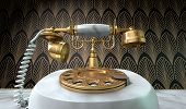 stock photo of embellish  - A vintage marble and brass telephone with a handset and dial embellishments on a marble shelf on an art deco wallpaper background - JPG